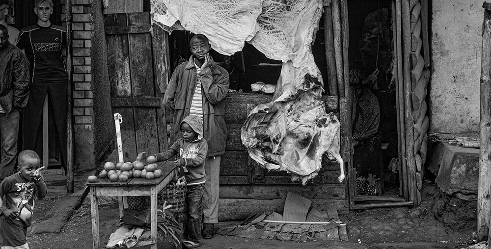 Photographing the Ugandan Medicine Man.